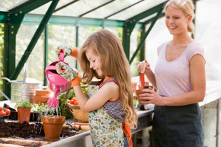 kids and parents gardening